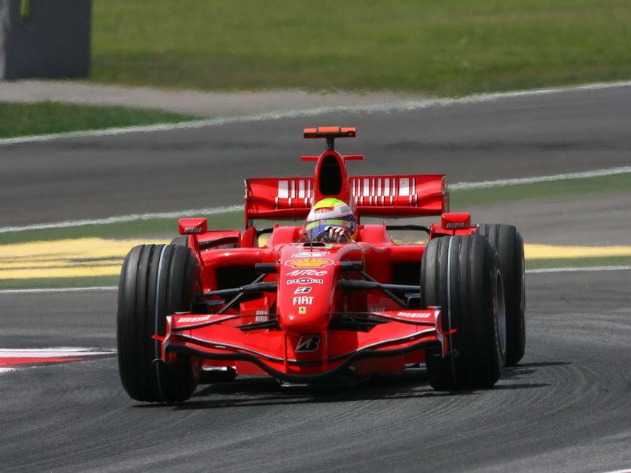 f1 法拉利赛车比赛中场景 f1将从2013年起正式换用1.高清图片